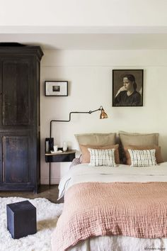 Tones of blush and creams combine with dark wood for a soothing bedroom.