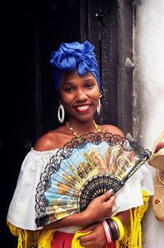 Young woman in typical Cuban dress holding a fan, Habana Vieja, Havana, Cuba, West Indies, Central America : Stock Photo