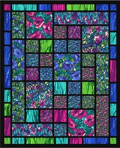 Stained glass quilt  (Do this with all the asian prints I have!  Would be amazing!)