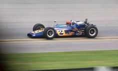Al Unser blasts out of the pits during his victorious 1970 Indy 500 win in his LolaColt 'Johnny Lightning Special'…
