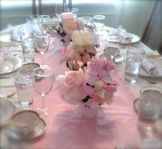 Baby girl shower. Table runner made with pink and white gingham and edged with tulle.