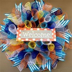 """20"""", Spring & Summer Orange Polka Dotted 'Welcome' Spiral Mesh Wreath in Light Turquoise Blue, Orange, White, Royal Blue, Gray & Yellow with Turquoise & White Striped Ribbon : $40 Made by Red-y Made Wreaths. Like & Follow us on Facebook https://www.facebook.com/pages/Red-y-Made-Wreaths/193750437415618 or Visit us at http://www.redymadewreaths.com/"""