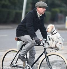 Ewan McGregor via http://www.dailymail.co.uk/tvshowbiz/article-1368275/Ewan-McGregor-looks-inch-British-Gent-flat-cap-takes-dog-ride-vintage-style-bicycle.html