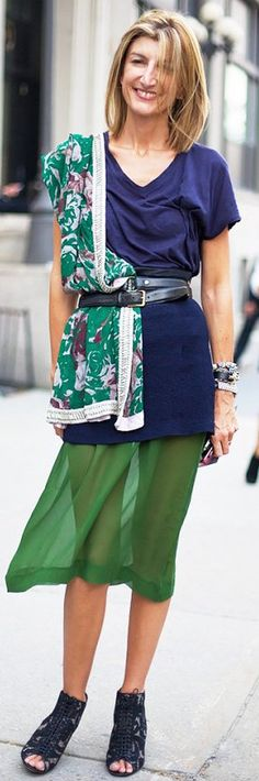 Sheer skirt worn with simple short sleeve tee, open-toe boots and belted printed scarf