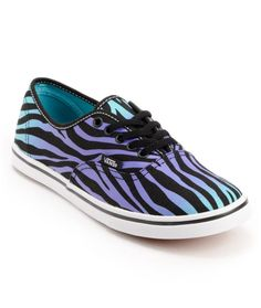 Run free in the girls Vans Authentic Lo Pro in the black, purple, and Scuba blue faded colorway with an all-over zebra stripe print.