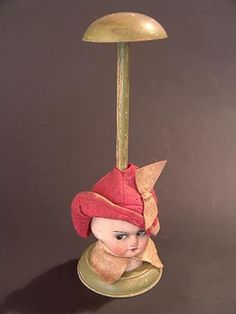 1920'S DOLL FACED HAT STAND