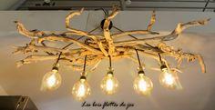 lustre composé de multiples branches de bois flotté