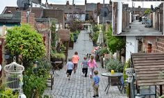 Gardening? It's right up our alley! Community transforms Victorian passageway behind homes into oasis of greenery