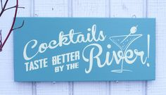 Cocktails Taste Better by the River sign   Community Post: 15 Creative Cocktail Inspired Crafts You Can Own