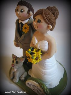 Wedding Cake Topper, Custom Bride, Groom and Cat with Date Plaque and Sunflowers, Polymer Clay Wedding/Anniversary Keepsake. $165.00, via Etsy.