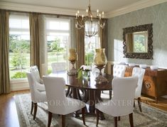 This eclectic dining room displays a traditional base with contemporary accents for an updated, eye-catching combination.