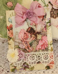 I altered a white box that I purchased at Michael's by using a decoupage medium and a beautiful roste napkin. I used my Tattered Angels to ...