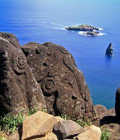 Orongo petroglyphs with Motu Nui islands in the background.