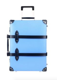 GLOBE TROTTER Wheeled luggage. logo, solid color, framed closure.  Such a pretty powder blue. Will definitely stand out at baggage claim.  A.L. Included.