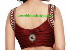 Stylish Pearl Embellished Blouse – Trendy sleeveless blouse with pearl work over the shoulders and pleated back with a brooch studded at the center by The Blouse Factory. Best Blouse Designs, Simple Blouse Designs, Saree Blouse Neck Designs, Stylish Blouse Design, Bridal Blouse Designs, Blouse Patterns, Sewing Patterns, Dress Designs, Women's Fashion
