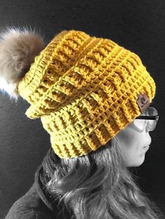 This pattern contains instructions on how to make the textured Brooklyn Beanie in 3 styles. The regular beanie, slouch beanie, and messy bun beanie.