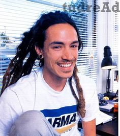 Brandon Boyd... Lead singer of Incubus... the wild hair, gages and tattoos  <3