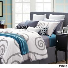 EverRouge Serenty 7pc cotton duvet set | Well said by its name, this duvet set will bring you peace and serenity. The abstract pattern and calming color combination of this bedding set will sweep you off your feet and take you far away from your troubles.  Set includes: duvet, 2 shams, 2 euro shams and 2 filled dec pillows with removable covers | Overstock.com $120