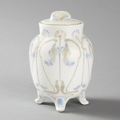 This is not contemporary - image from a gallery of vintage and/or antique objects. French Art Nouveau Covered Porcelain Jar by de Feure A French Art Nouveau covered porcelain jar designed by Georges de Feure and manufactured by Dufraisseix & Abbot, Limoges for Art Nouveau Bing. In the manner of de Feure's renowned textiles, this piece is decorated with elegantly painted abstract floral and vegetal designs.