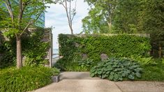 Hoerr Schaudt's landscape design for this three-acre site overlooking Lake Michigan gradually moves the strikingly contemporary residence, by architect Peter Gluck, from a suburban condition upon arrival to a more natural setting as it approaches the water.