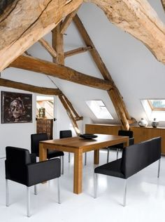 black and white and wood in attic dining room