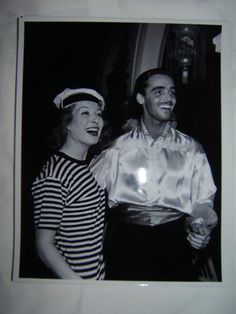 Looks like Garson at a costume party with husband (#2) at the time - Richard Ney.