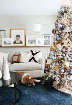 love this flocked family tree in a cozy living room