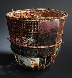 contemporary basket        by John Garrett        Fiber construction with alternative and recycled materials, including wire, hardware cloth & metal.