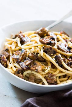 An easy, 15 minute recipe where the traditional spaghetti aglio olio is dressed up with sautéed mushrooms. Perfect for meatless weeknights and a hit with the kids!
