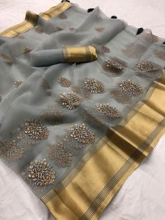 Beautiful Organza silk saree with Floral Thread. Embroidered work on allover the saree. The saree great for gift and wear for wedding, function, event, party or as you want. saree with matching blouse piece.