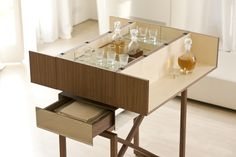 """""""Nando"""" Trolley bar cabinet with walnut base, maple shelves, chromed metal frame and mirrored drawers. Pinworthy Tables and Consoles We Love at Design Connection, Inc. 