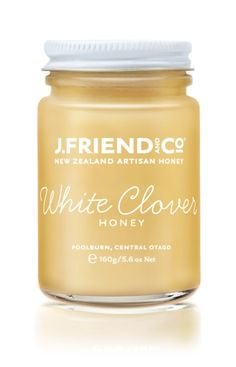 clear jar label with white ink and cool typeface   J.Friend and Co Honey