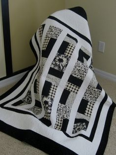 black and cream quilt - So pretty! this is inspiration only.  but looks pretty simple to make!