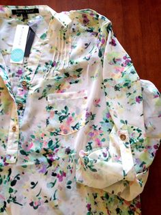 I like how pretty the print on this top is! Sweet Rain Isaac Floral Print Tab-Sleeve Blouse