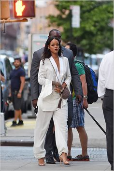 Rihanna looks stunning in a white pants suit while out in SoHo, NYC