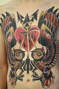 owl heart arrow chest tattoo
