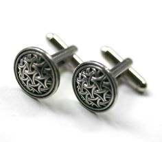 Celtic Eternity Knot Cuff Links. $24.00, via Etsy. i wish matthew wore suits so i could get these for him :)