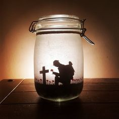 Items similar to and Remembrance memorial jar light. Soldier in a poppy field (lest we forget), flanders fields. Mason jar on Etsy Remembrance Day Pictures, Remembrance Day Activities, Remembrance Day Poppy, Wedding Remembrance, Mason Jar Crafts, Mason Jar Diy, Anzac Soldiers, Soldier Silhouette, Poppy Craft