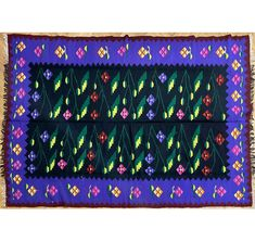 Oltenian carpet, beautifuly made, black and elegant purple background with sweet floral design. It is a vintage item, suitable for many styles, bohemian, romantic, elegant or clasic with an elegant touch of color. Floral Rug, Floral Design, Purple Backgrounds, Rug Making, Purple And Black, Rugs On Carpet, Wool Rug, Hand Weaving, Vintage Items