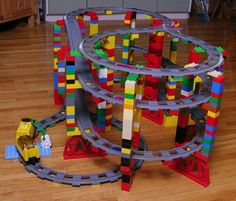LEGO Duplo. Hmmm not sure we have enough track pieces but will give this a try.