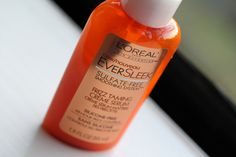 """L'oreal EverSleek sulfate-free frizz taming creme serum.  This helps tame my frizz and fly-aways on the top of my head and the consistency is perfect and doesn't make my hair too """"crunchy""""."""
