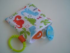 Pacifier Pouch Reusable Kids Zipper Snack Bag With Clip On Handle 5x5 Dinosaur Land. $7.50, via Etsy.