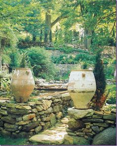 Michael Trapp, large Spanish pots mark the reflecting pool in the garden