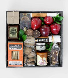 Massachusetts shines through with Doves & Figs' autumn jam, Coop's salted caramel sauce, and local apples: 'Taste of New England' by Winston Flowers.
