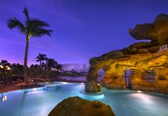 Unwind beneath a Pacific Ocean sunset at Ka Maka Grotto, an oceanfront infinity pool area at Aulani, A Disney Resort & Spa in Hawai'i.