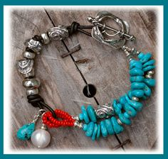 """Untamed Spirit Bracelet... -Sleeping Beauty Turquoise Sliced Nuggets -Old African Red """"White Hearts"""" -Artisan Crafted Silver Sliders -Artisan Crafted Silver Toggle -Black Greek Leather  ::bracelet measures.......7.5 inches"""
