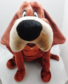 Disney Lady and the Tramp Trusty Plush by Disney. $74.95. High quality. Polyester. 21 inches tall. Very detailed. The beloved Bloodhound, Trusty, from Disney's Lady and the Tramp returns in plush form. This beautifully detailed toy will make any child or Disney collector happy!