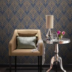 Astoria Deco Wallpaper Dark Blue and Gold Rasch 305340 This stunning Astoria Deco wallpaper features an eye-catching geometric art deco style pattern in gold, with a subtle mica sheen and glitter highlights. This is embedded onto a matte dark blue background with a soft textured finish. Easy to apply, this high quality vinyl wallpaper would look great as a feature wall or equally good when used to decorate a whole room. A stunning art deco inspired wallpaper Features mica and glitter…