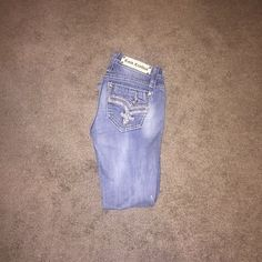 Rock Revivals Size 27, hemmed to a 28 length. These are now to short and big on me! Great Condition!No Trades. Firm Price. Rock Revival Jeans Boot Cut