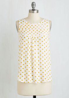 Wake up with your favorite things - a warm brew, your weekly book, and this winsome white top. Catching the morning sun in its airy woven fabric, this feminine tank stars sunflower yellow spots and pintucking at the neckline that look oh-so splendid beside your darling decor.
